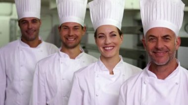 Four cheerful chefs making ok sign — Stock Video