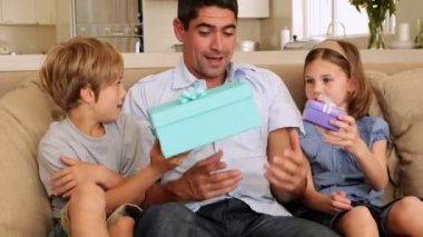 Cute children giving their father presents — Stock Video