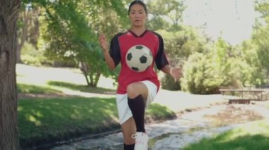Asian girl playing football in the park — Stock Video