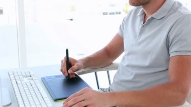 Graphic designer using digitizer at his desk — Stock Video