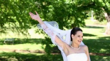Beautiful bride throwing her bouquet — Stock Video