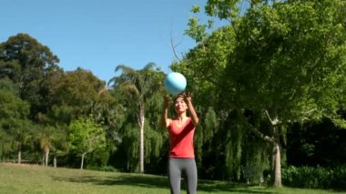 Sporty brunette playing football — Stock Video