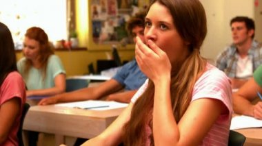 Student yawning in classroom — Stock Video