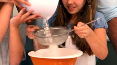 Family making cake batter together — Stock Video