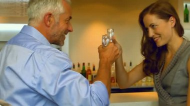 Business colleagues drinking a shot together — Stockvideo