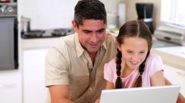 Father using the laptop with his daughter — Stock Video