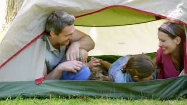 Funny family in their tent on a camping trip — Stock Video