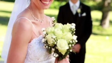 Pretty bride with groom standing in background — Stock Video