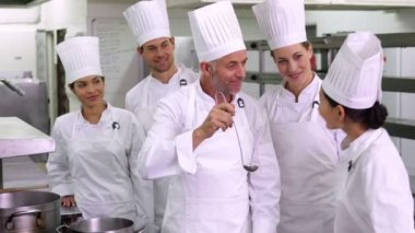 Team of chefs giving ok sign to camera — Stock Video