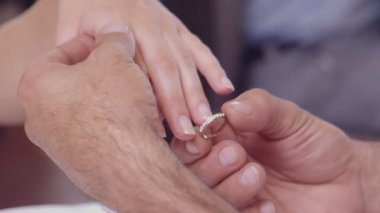 Man placing ring on womans finger — Stock video