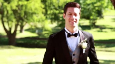 Attractive groom walking towards — Stock Video