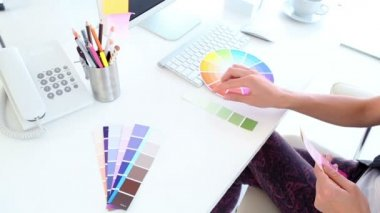 Graphic designer looking at colour samples — Stock Video