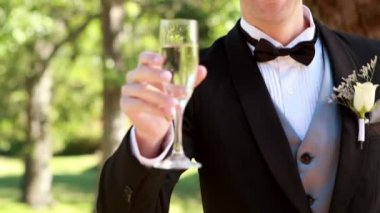 Happy groom toasting with champagne — Stock Video