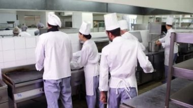 Chefs at work in a busy kitchen — Stock Video