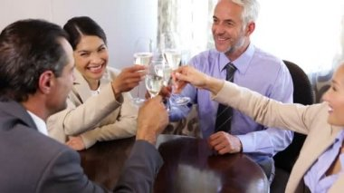 Business associates drinking champagne after work — Stock Video