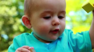 Adorable baby boy playing on the grass — Stock Video