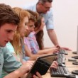 Students working in computer room with lecturer — Stockvideo