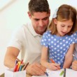 Cute parents and daughter colouring together — Stock Video #42662645