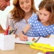 Parents and daughter colouring together at the table — Stock Video