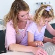 Mother and daughter using laptop together — Stock Video #42667561