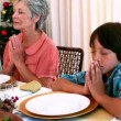 Extended family saying grace before christmas dinner — Stock Video