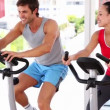 Fit couple working out on exercise bikes — Stock Video #42668955