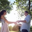 Happy couple dancing in the park — Stock Video #42669021