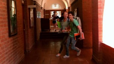 Happy students running through a hallway — Stock Video