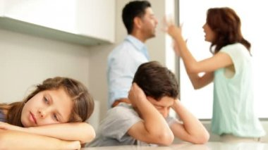Upset siblings covering their ears while their parents fight — Wideo stockowe