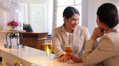 Businesswomen having a glass of beer after work — Stock Video