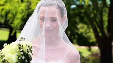 Pretty bride with veil over her face — Vidéo
