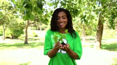 Happy environmental activist holding a shrub — Stok video