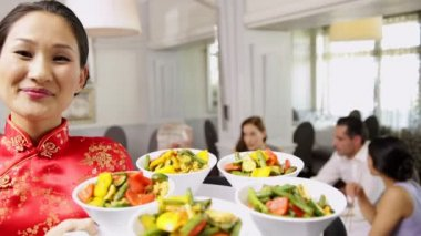 Waitress presenting tray with bowls of vegetables — 图库视频影像