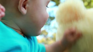 Adorable baby boy playing with teddy bear — Vidéo