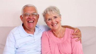 Senior couple sitting on sofa — Stock Video