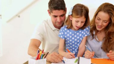 Cute parents and daughter colouring together — Vidéo