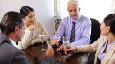 Business associates drinking wine after work — Stock Video
