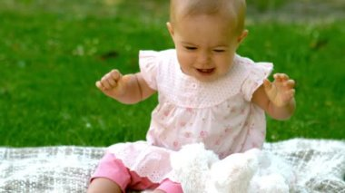 Baby laughing in the park on the blanket — Stock Video