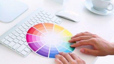 Graphic designer using colour wheel at his desk — Stock Video