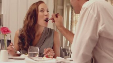 Man feeding his brunette wife — Stok video