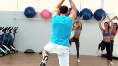 Aerobics class exercising together — Stockvideo