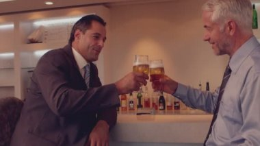 Businessmen having a beer together — Стоковое видео