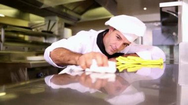 Handsome chef wiping down the counter — Stock Video