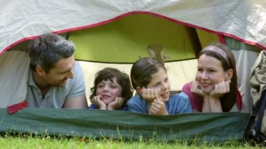 Happy family on a camping trip in their tent — Stock Video