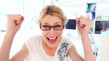 Excited businesswoman cheering at camera — Stock Video