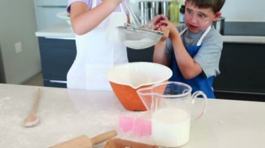 Siblings making a cake together — Stok video