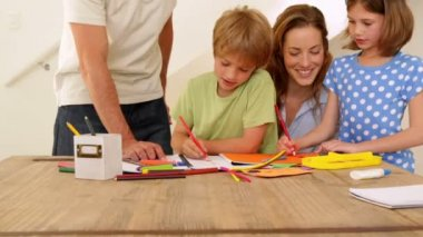 Happy parents and children drawing together at the table — Vidéo