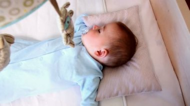 Baby boy sleeping in crib — Stock Video