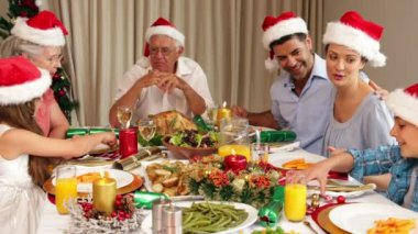 Smiling extended family at the christmas dinner table — ストックビデオ