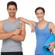 Fit young couple with exercise mat and water bottle — Stock Photo
